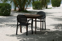 Empty Table and Chairs on Beach Stock Photography