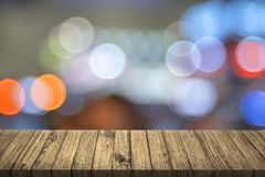 Empty table with colorful bokeh. 3D illustration. City light con Stock Photos