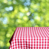 Empty table. And defocused fresh green background Stock Photos