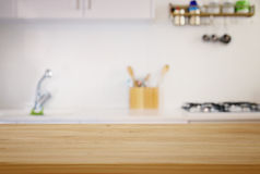 Empty table and defocused modern kitchen background. Empty table board and defocused modern kitchen background. product display and picnic concept Stock Photo