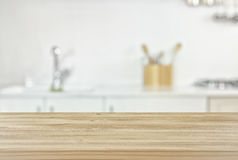 Empty table and defocused modern kitchen background. Empty table board and defocused modern kitchen background. product display and picnic concept Stock Image