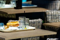Empty table with dirty dish street cafe Royalty Free Stock Image