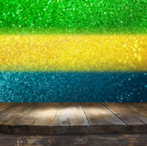 Empty table in front of abstract glitter lights using brazil fla