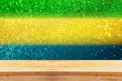 Empty table in front of abstract glitter lights using brazil fla Royalty Free Stock Photos