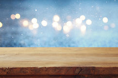 Empty table in front of blue glitter lights background Stock Image
