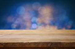 Empty table in front of blue glitter lights background Royalty Free Stock Images