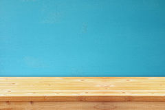 Empty table in front of blue wooden background Stock Photos