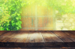 Empty table in front of blurry antique wooden door Royalty Free Stock Photography