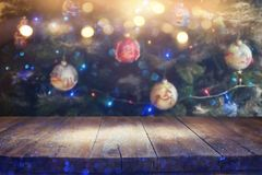 Empty table in front of christmas tree with decorations background. For product display montage.  royalty free stock photos