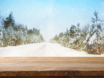 Empty table in front of dreamy winter landscape background Royalty Free Stock Images