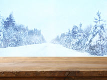 Empty table in front of dreamy winter landscape Stock Photos