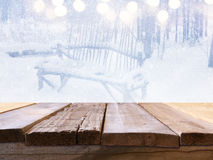 Empty table in front of dreamy winter landscape Stock Images