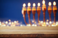 Empty table in front of jewish holiday Hanukkah background Royalty Free Stock Photo