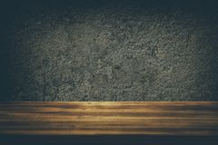 Empty table in front of old wall background. For product display. Royalty Free Stock Photography