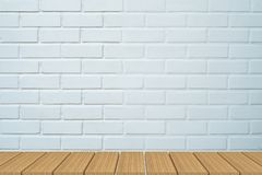 Empty table in front of white brick background. stock image
