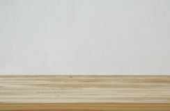 Empty table in front of white wall texture background. For product display montage royalty free stock photography