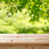 Empty table in the garden. Wooden table for background against blurred garden Stock Photo