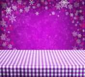 Empty table. Empty gingham table with violet christmas background Stock Photos