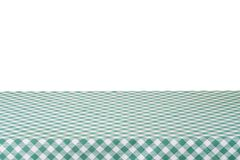 Empty table with green tablecloth isolated on white background,. For food and product display montage Stock Image