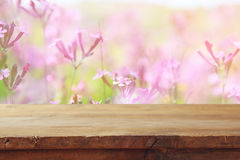 Free Empty Table In Front Of Spring Field Flowers Background Royalty Free Stock Image - 88314516
