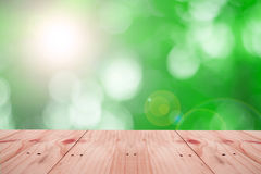 Empty table on Natural green motion blur abstract Stock Images