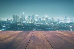 Empty table on night city background. Empty wooden table on night city background. Mock up, 3D Rendering Stock Image