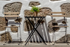 Empty table outside local cafe stock images