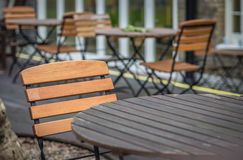 Empty table outside local cafe Royalty Free Stock Images