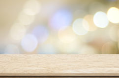 Empty table over blur festive bokeh background Royalty Free Stock Photography