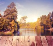 Empty table over blurred trees and river as background, product display template royalty free stock photography