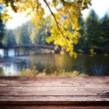 Empty table over blurred trees and river as background, product display template stock photos