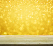 Empty table over gold blur light with shiny starry, Christmas ba Stock Photo