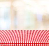 Empty table with red check tablecloth over blur festive bokeh ba Royalty Free Stock Image