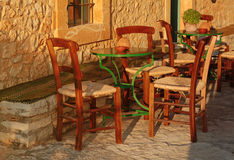 Empty table at street village restaurant, Crete, Greece. Sunset Stock Photo