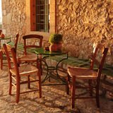 Empty table at an street village restaurant, Crete, Greece Stock Photography