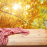 Empty table and tablecloth. Nature background outdoors. Stock Photography