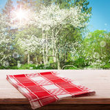 Empty table and tablecloth. Nature background outdoors. Empty table and tablecloth, Spring background, for product display montage. Mock up for design Royalty Free Stock Photography
