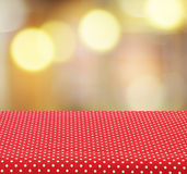 Empty table with tablecloth over blur bokeh background. For product display montage Stock Photography