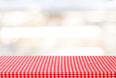 Empty table with tablecloth over blur bokeh background Stock Image