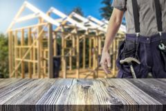 Handyman / craftsman and house framework blurred in the background. Renovate and royalty free stock images