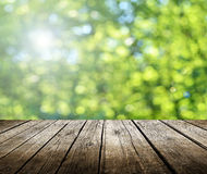 Empty table. Empty wooden deck table with spring background. Ready for product display montage Royalty Free Stock Image