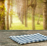 Empty tablecloth on wood table. Stock Photo