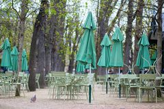 Empty tables of a cafe in Luxembourg garden Royalty Free Stock Photo
