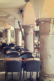 Empty tables and chairs of coffe bar to outdoor porticoed. stock photography
