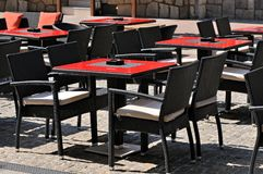Empty tables and chairs in a outdoor cafe Stock Image