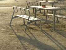 Empty tables and chairs outdoors