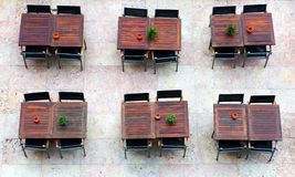 Empty tables with chairs outside the cafe in Lisbon Royalty Free Stock Photos