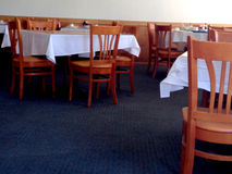 Empty tables and chairs at restaurant Royalty Free Stock Photo