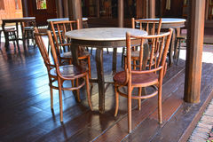 Empty tables and chairs in restaurant, Thai style. Stock Photos