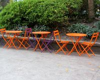 Empty tables and chairs in a street cafe Royalty Free Stock Photo